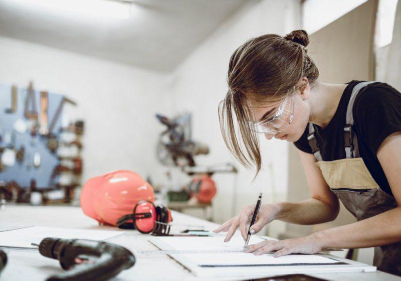 female carpenter at work bench