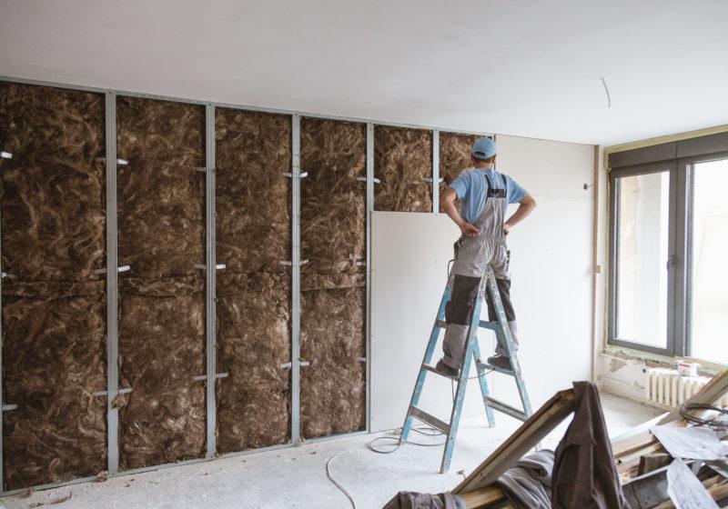 man installing wall lining