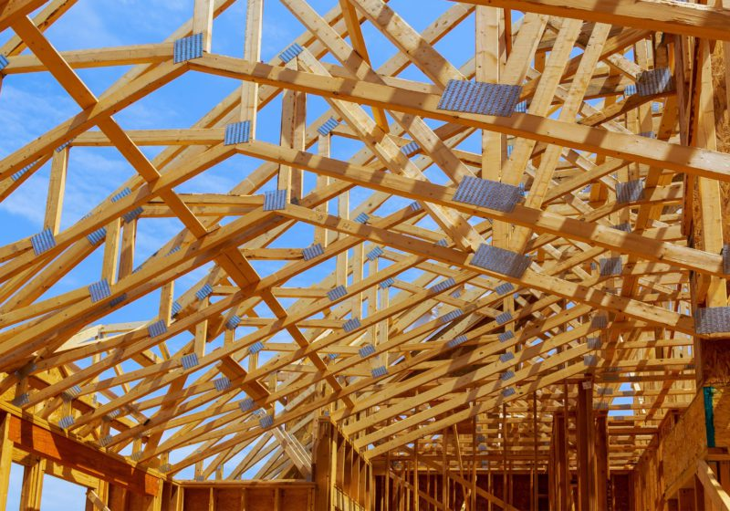 structural wooden beams in place on construction site
